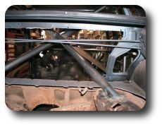 Rear support bars welded to shock towers, view from trunk.